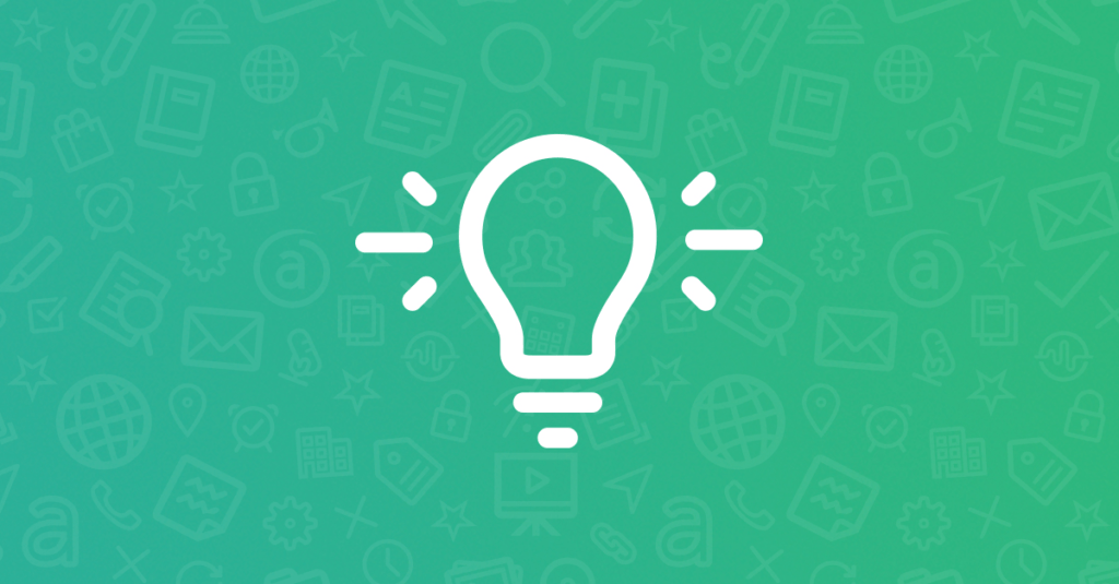 Lit Lightbulb on Green Background