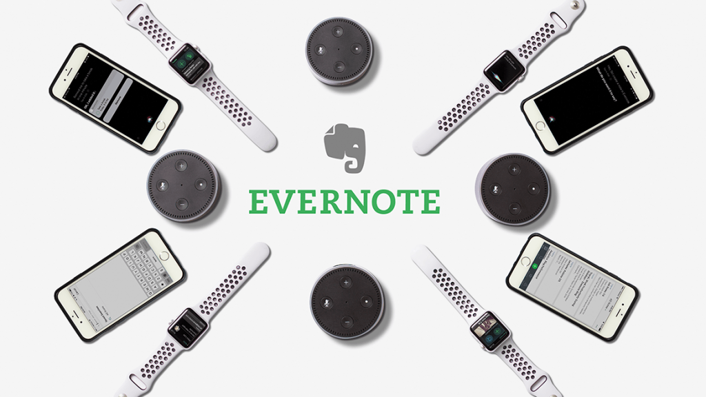 Gadgets on a white surface with the Evernote logo in the middle