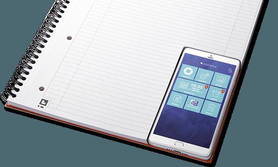 Smartphone mit Scribzee App auf einem Notizblock