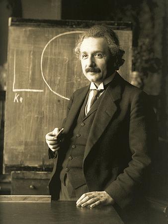 Albert Einstein in front of Blackboard
