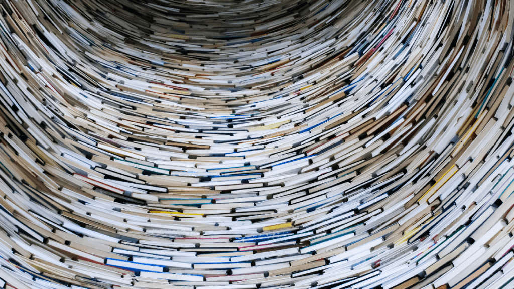 A lot of books stacked on top of each other