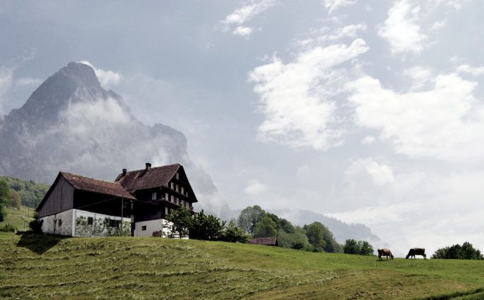 House in Ried Switzerland with Mountain in Background
