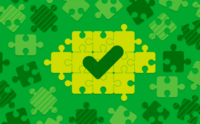 Illustration of puzzle pieces coming together to reveal a dark green checkmark.