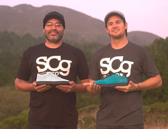 SCg Shoe Co's Andrew Burke and CEO/Founder Steven Caro show off two of the company's footwear designs.